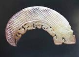 狮子山龙形玉佩:玉器史上威猛时代的绝唱